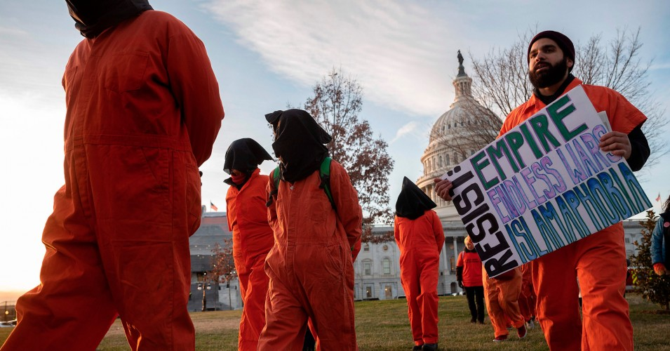Demonstrators dressed in Guantánamo Bay prisoner uniforms march past Capitol Hill in Washington, D.C., on January 9, 2020. (Photo: Jim Watson/AFP via Getty Images)