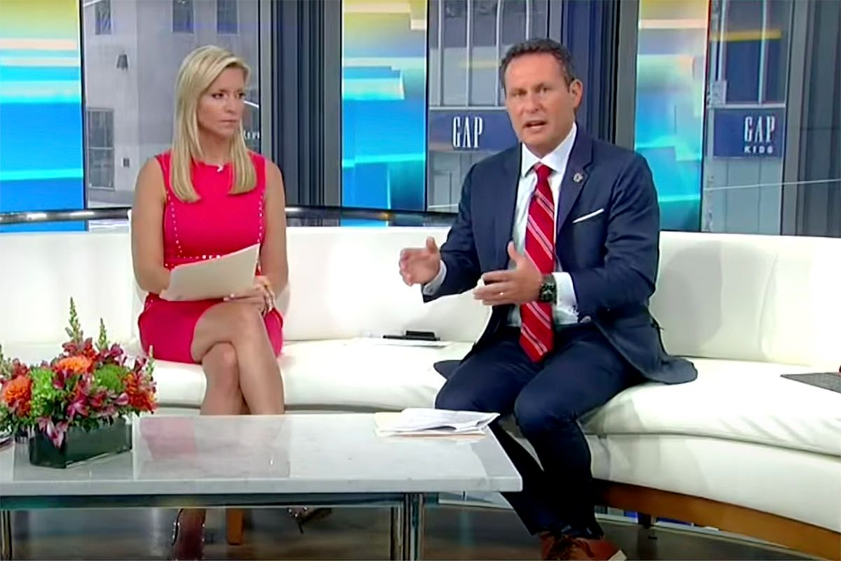 Brian Kilmeade and Ainsley Earhardt discuss critical race theory on Fox and Friends. (Getty Images)
