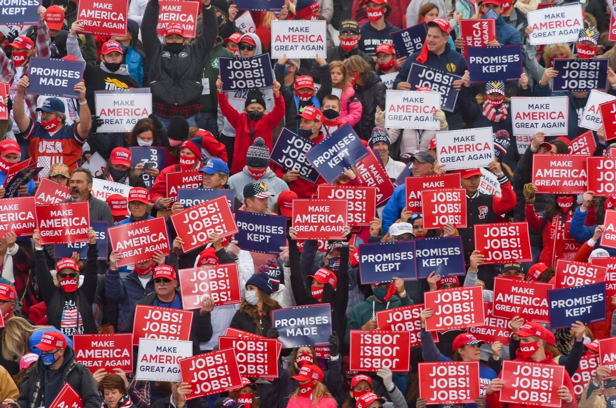 Supporters of then-President Donald Trump hold signs at a rally in Pennsylvania. (Getty Images)
