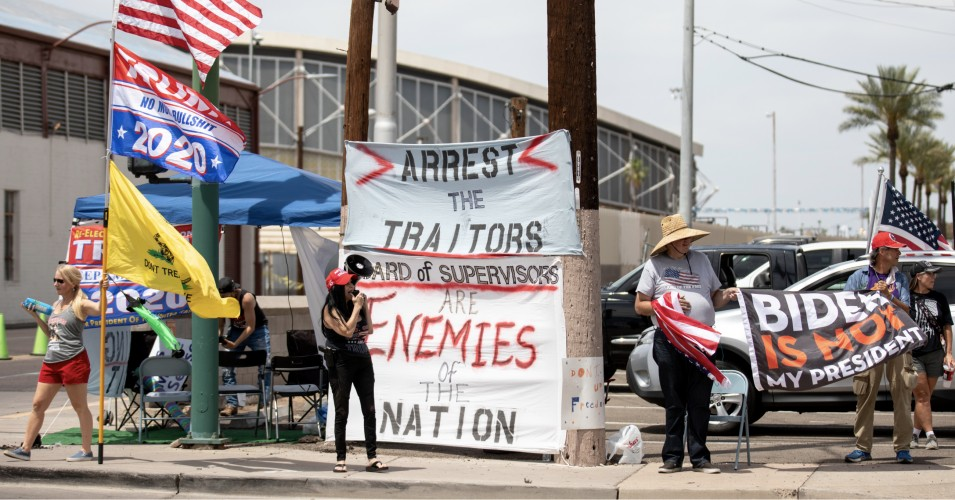 Protestors in support of former President Donald Trump gather outside Veterans Memorial Coliseum where ballots from the 2020 general election wait to be counted on May 1, 2021 in Phoenix. The Maricopa County ballot recount comes after two election audits found no evidence of widespread fraud in Arizona. (Photo: Courtney Pedroza/Getty Images)