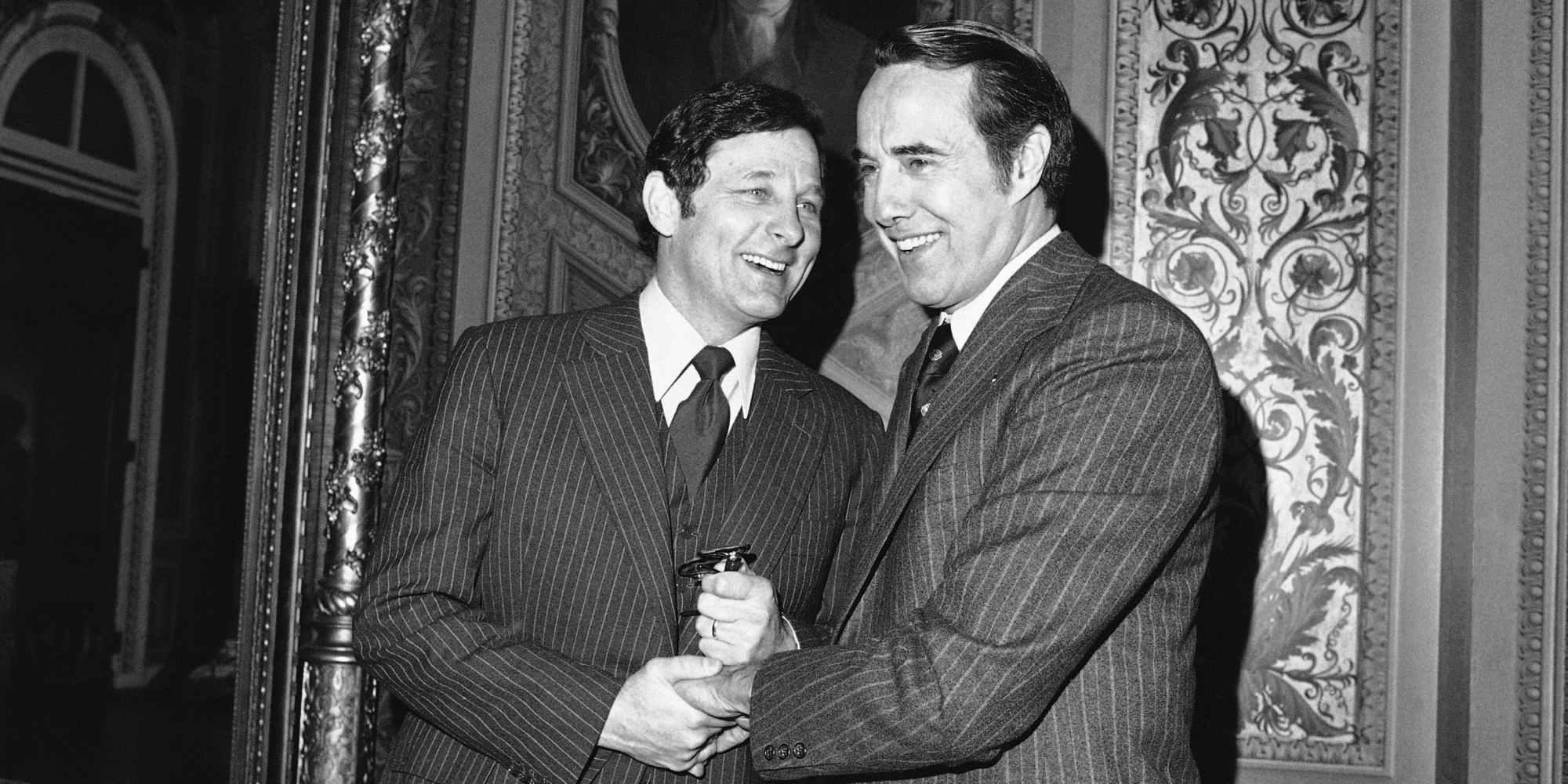 Sen. Birch Bayh, D-Ind., and Sen. Bob Dole, R-Kan., right, get together on Tuesday, Feb. 21, 1978 at the Capitol during a break in a closed session of the Senate that is discussing the Panama Canal treaties. Dole said he would move to make public charges involving Gen. Torrijos and members of his family being involved in drug traffic. Bayh, as chairman of the Senate Intelligence Committee, has custody of classified files dealing with the allegations. (AP Photo/ John Duricka)