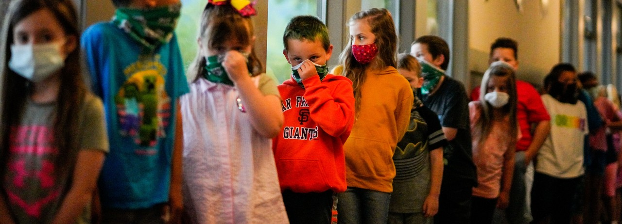 Students and children wearing masks during the Covid-19 pandemic.