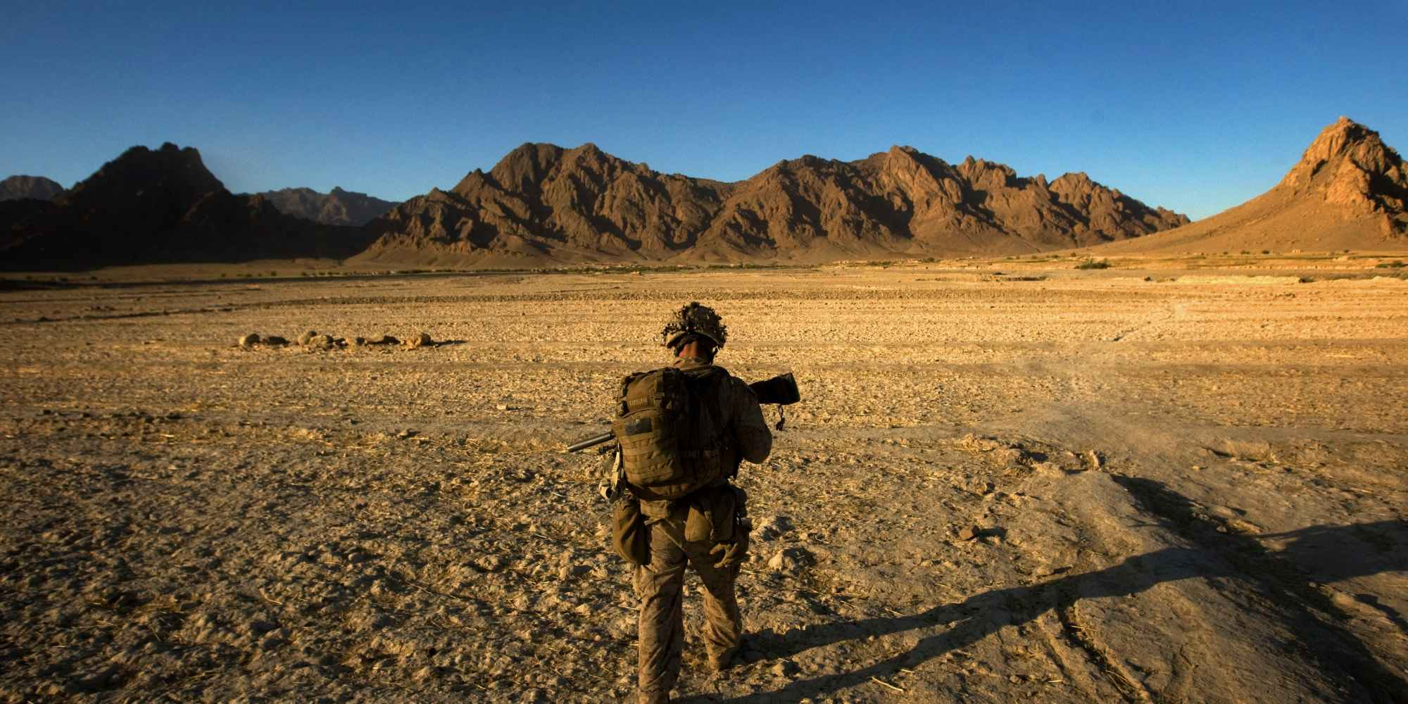 A U.S. Marine patrols as his platoon searches house to house during day three of Operation Germinate in Farah Province, Afghanistan, on Oct. 9, 2009.