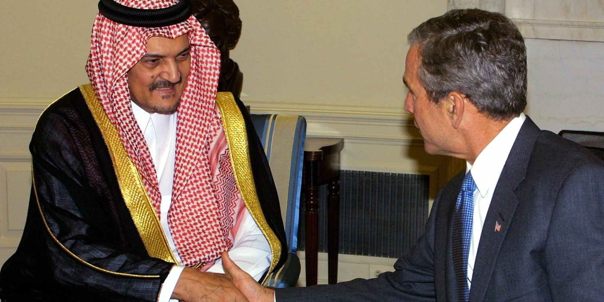 US President George W. Bush (R) meets with Kingdom of Saudi Arabia's Foreign Minister Saud al-Faisal (L) 20 September 2001 in the Oval Office of the White House in Washington, DC.